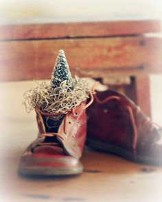 Red baby shoe with mini tree. Christmas