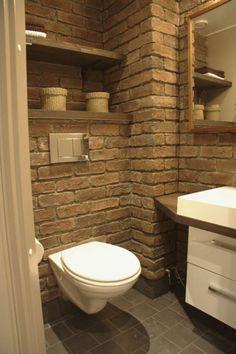 Create a Rustic Bathroom by using rustic elements to your modern bathroom. Rustic Bathrooms, Modern Bathroom, Small Bathroom, Bathroom Ideas, Modern Wall, Brick Bathroom, Bathroom Wall, Wall Mounted Toilet, Interior Exterior