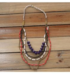 Ilunga Ugandan Paper Necklace, red, blue, black, and white paper bead necklace from 22STARS