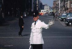 """Ireland A Garda directing traffic on Dame Street in Dublin. This just in from freethedub who says: """"Looks like my grandfather who was stationed in Pearse Street Station, Garda Patrick Chambers until his retirement in Date: June 1963 Dublin Street, Dublin City, County Cork Ireland, Galway Ireland, Ireland Vacation, Ireland Travel, Ireland Homes, Ireland Landscape, Vintage Dog"""