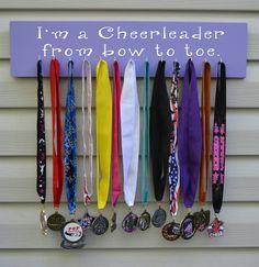 SPORTS MEDAL HOLDER Cheerleading Crafts, Cheerleading Bedroom, All Star Cheer, Cheer Mom, Cheer Stuff, Cheer Gifts, Bow Display, Award Display, Spirit Gifts