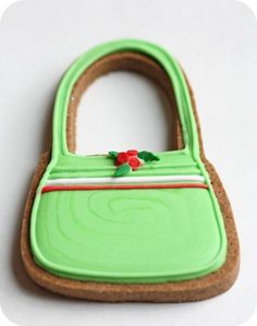 Image from http://sweetopia.net/wp-content/uploads/2010/12/handbag-decorated-cookie_picnik.jpg.