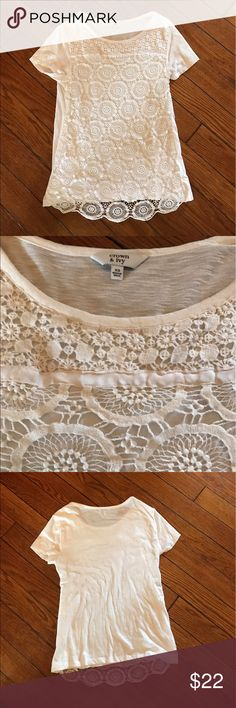 White Crochet top White crochet top by Crown and Ivy.  Beautiful details and trendy for spring and summer.  High quality and well made.  Stretchy, t-shirt material in the back and under crochet material.  26 inches long, 30 inch bust. Tops Tees - Short Sleeve