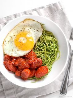 Vibrant green parsley pesto pasta pairs perfectly with sweet blistered cherry tomatoes and a the creamy yolk of a fried egg. Take your pasta up a notch. BudgetBytes.com