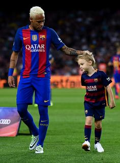 Neymar Jr. of FC Barcelona holds his son Davi Lucca prior to the La Liga match…