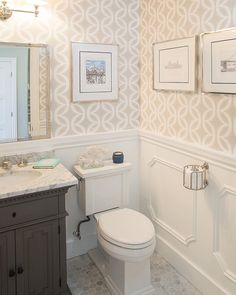 I just love how wallpaper can add so much interest to a simple powder room! By Rockstar Builders