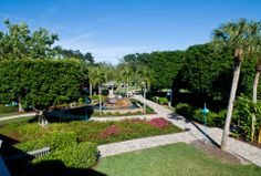 Spend the day here at Periwinkle Place. You'll enjoy exploring our lush landscaping, tropical fountains and butterfly garden while you peruse our wonderful selection of shops! Play And Stay, Sanibel Island, Fort Myers, Future Travel, Periwinkle, Places To Eat, Lush, Exploring, Landscaping