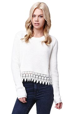 """The LA Hearts Crop Long Sleeve Crochet Hem Sweater features a soft stretchy fabric with a crochet detail hem. We love this sweater paired with bold patterns.   20"""" length 24"""" sleeve length Measured from a size small Model is wearing a small 59% cotton, 41% acrylic Machine washable Imported"""