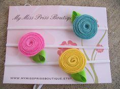 You choose 6 felt flower headbands...baby headband....toddler headband....girl headband...6months to 2T. $15.00, via Etsy.