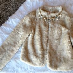"Faux Fur Coat Super warm and soft coat. Beige color. Sz small. Necklace not included. Clean, Smoke Free Home.  All Sales Final.  Fast Ship! Thanks! Check out my other items!                                                ✨✨✨✨✨15% off when bundled with another listing ✨✨✨✨  **NO TRADES or HOLDS PLZ** **will not reply to ""lowest""** Old Navy Jackets & Coats"