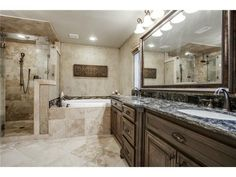 Great master bath // Dual sinks, oversized mirror, walk-in shower, soaker tub