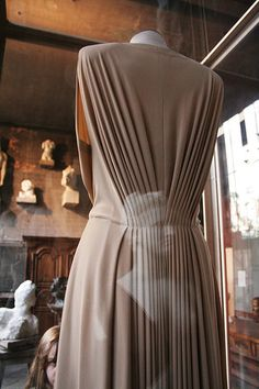 My fingers are itching to touch.  Madame Gres Grecian Dress - beautiful gathering / pleating detail