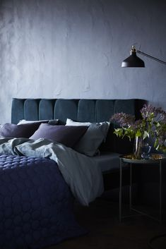 This sumptuous upholstered headboard is actually a really easy #IKEAHack - straight from their website.   It uses a MALM bed with some deep green SANELA velvet curtains.
