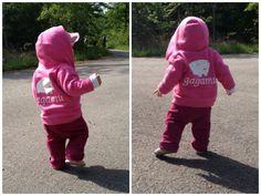 Toddler wearing pink gagamu sweater with white gagamu print.