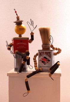 Tin Can men w wire hands and beaded legs