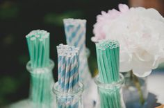 Milk bottles  straws (but pink and grey) for cocktail hour