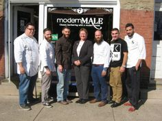 """Staff members from Modern Male Barbershop in Sellersville present funds raised during a cut-a-thon event to Grand View Hospital's radiation oncology manager, Dorothy Barwis, center. Pictured from Modern Male are, from left, Ryan """"Ziggy"""" Ziegler, Bryan Kelly, Ray Spear, Nic Prosseda, Drew Kratz and Mark Shilling. Modern Male Barbershop employees raised $1,600 benefiting Grand View Hospital's commitment to men's health and promoting cancer awareness. Photo courtesy of Grand View Hospital"""