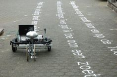 Dutch artist Gijs van Bon's Skryf machine takes graffiti to a different level - Van Bon's adapted CNC milling machine uses sand to write words on the ground, spelling out messages and texts, letter by letter, to be blown away by wind or scuffed out by the soles of pedestrian foot traffic.