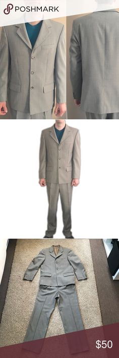 """Gray Men suit 40R Pre-loved in excellent conditions. Gray with tones of brown. Super hard to take pictures of the true color.  Jacket and pants deal. Jacket measurements: length 27 1/2"""" Sleeve length 25"""" pit to pit  22 1/4"""" pants measurements: waist 33"""" inseam 30"""" total length 42"""". My model and previous owner is 6'  and 160lb . Usually wears 32x32 jeans. Thanks for stopping by 😉 Suits & Blazers Suits"""