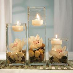 déco de  mariage en orchidées et bougies flottantes