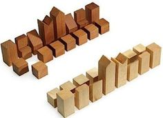 What a cool minamilist chess set.  All you need is two kinds of reclaimed wood, and you're set, literally!