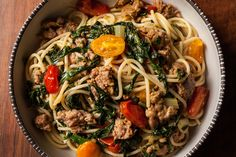 A quick and easy spaghetti recipe with Italian sausage, Swiss chard, and sautéed cherry tomatoes.