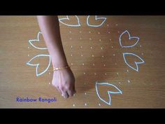 Beautiful rangoli with dots | Simple kolam with dots | Easy Muggulu | Rainbow Rangoli - YouTube