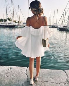 White cold shoulder dress.
