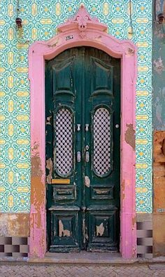 Portugal. What a colorful door concept, I love to see how things are so different world wide. :