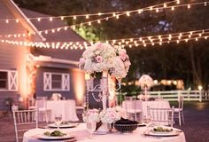 Fabulous #centerpiece at this #outdoor #orange #uplighting #wedding #reception ! #diy #diywedding #weddingideas #weddinginspiration #ideas #inspiration #rentmywedding #celebration #party #weddingplanner #weddingplanning #eventplanner #eventplanning #dreamwedding By #ElanEvents