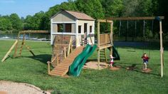 Fun club house with swings, slide, climbing structure, and more.