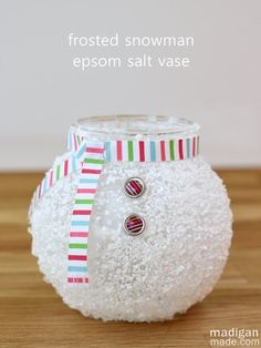 Epsom Salt Snowman Vase ~ Madigan Made { simple DIY ideas }Supplies needed:  Fish bowl vase Epsom salt White, translucent glass paint (or you could use decoupage) Foam brush Spray acrylic or lacquer sealer Ribbon Scissors Small buttons or decorative brads (with the tabs trimmed off the back) Hot glue.