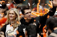 San Francisco Giants' Buster Posey and his wife Kristen wave to fans as the San Francisco Giants celebrate their World Series Championship with a parade up Market Street in downtown San Francisco, Calif., on Wednesday Oct. 31, 2012. Photo: Michael Macor, The Chronicle / SF