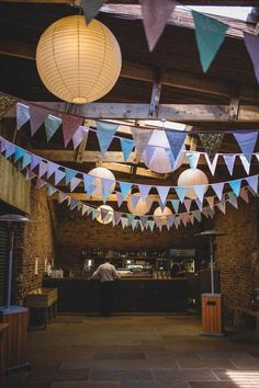 Like this with the bunting and lanterns