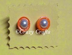 Orange and white stud earrings