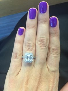 Emerald cut 2 carat diamond engagement ring with octagonal halo set in platinum.