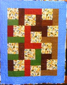 Postcards from Wisconsin are featured on this kit quilt.