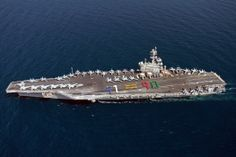 ARABIAN SEA (April 13, 2014) Sailors of the aircraft carrier USS George H.W. Bush (CVN 77) assemble in formation on the flight deck in honor of the ship's namesake's 90th birthday on June 12, 2014. George H.W. Bush is supporting maritime security operations and theater security cooperation efforts in the U.S. 5th Fleet area of responsibility. (U.S. Navy photo by Lt. Juan David Guerra/Released)