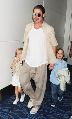Brad Pitt Takes Out the Twins After a Glamorous Night With Angie: Brad Pitt walked with Vivenne and Knox in Tokyo on Tuesday.