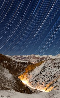 Star trails streak over a mountainous road in this moonlit winter night. Iran Travel, Star Trails, Sky Art, Winter Night, Persian, Asia, Waves, Stars, Outdoor