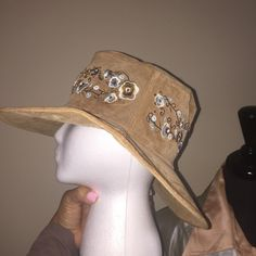 Suede Hat, fully lined. Tan w/embroidery. Suede Hat, fully lined. Tan with soft blue & white embroidery, a fun and seductive look. Accessories Hats