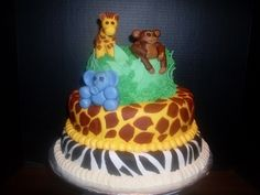This is a safari-themed baby shower cake, with 'baby' animals created from fondant and corresponding fondant-covered tiers.    Uploaded by Kimwa on Saturday Jan 19 12:55:02 2013  Submitted into the February, 2013 Inkedibles Contest