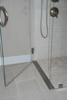 shower pan? Curbless shower with a linear drain at the door. soft gray tiles