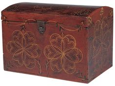 Artist unidentified Lancaster or Lancaster County, Pennsylvania c. 1800–1840 Paint on pine, with sheet-tin hasp and hardware 8 3/4 x 12 3/8 x 8 3/4 in. A number of these boxes share similarities of construction and painted decoration, suggesting a common maker or group of related makers. Stylized flowers, vines, and pinwheels are laid out with a compass over a base coat of red, blue, or blue-green, and painted freehand.