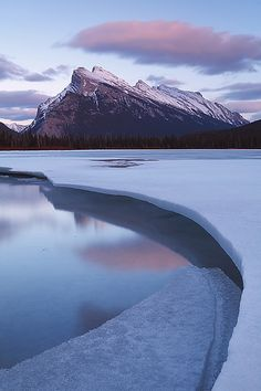 To see the ice coming off of the lake, a sure sign of spring and time to get out the canoe. Would love to paddle here, Banff National Park, Canada.