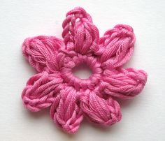 Updated flower in my new blog, includes video. Click here! Here instructions for the crocheted flower I used in the baby cardigan . ...