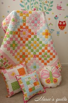 A totally charming,fresh looking, polka dot, postage stamp quilt...