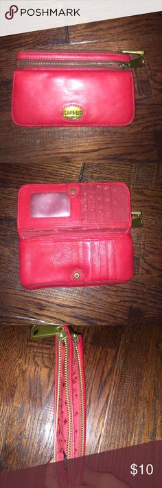 wallet this is a wallet that unbuttons to show some pockets and there are two bigger pockets on top all together there are 14 pockets Fossil Bags Clutches & Wristlets