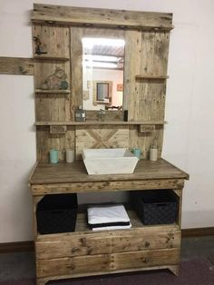 Next we are once again set with the idea of the wood pallet for your bathroom area. In this bathroom wood pallet option you will view the use of the mirror wood pallet. It is all accompanied with the access of the cabinets and drawers as well. It has one portion of the vanity too.