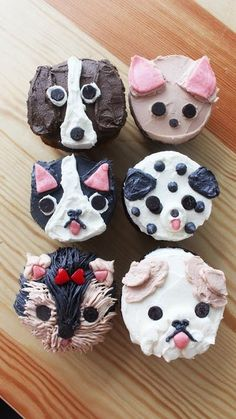 """Recipe with video instructions: Had a """"ruff"""" day? Rectify it with these adorable and delicious cupcakes. Ingredients: Buttercream:, 2 cups unsalted butter, room temperature, 1 teaspoon vanilla extract, 5 cups confectioner's sugar, 12 cupcakes, Regular and mini chocolate chips, Pink starburst candy, flattened, Red heart candies, for the Yorkie's bow Puppy Dog Cupcakes, Cupcakes For Dogs Recipe, Cute Cupcakes, Delicious Cupcakes, Cupcake Recipes, Starburst Candy, Pink Starburst, Chocolate Chip Cupcakes, Chocolate Chips"""